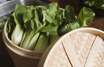 Remove damaged or yellowed leaves before preparing bok choy.