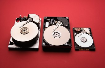 Hard drives store data on metal disks using magnetic heads.