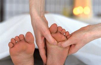 Reflexologists apply pressure to specific areas of the feet.