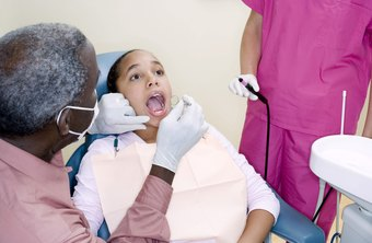 Dentists learn to evaluate and assess patients in an accredited dental school program.