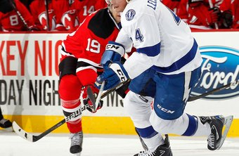 Vincent Lecavalier, right, signed an 11-year, $85 million contract with the Tampa Bay Lightning in 2008.