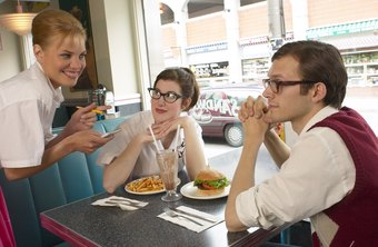 Waitresses serve customers at restaurants.