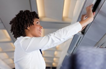 Flight attendants have to be tall enough to reach the overhead bins.