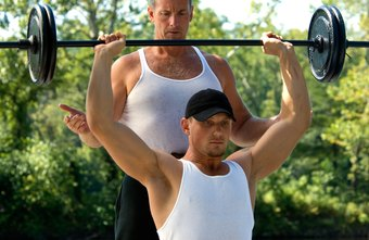Barbell presses target the front of each shoulder.