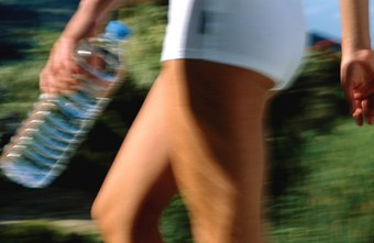 Cardio exercise, such as walking or running, helps you trim down all over.
