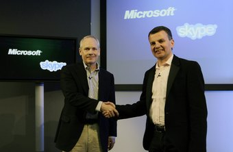 Microsoft and Skype executives us a PowerPoint presentation to announce a business deal.