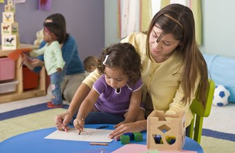 Daycare teachers show little ones how to draw.