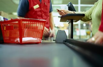 A checkout supervisor focuses on customer satisfaction.