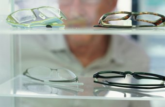Technicians help optometry patients select glasses and lenses after appointments.