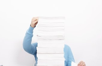 woman sorting stack of papers at closing time