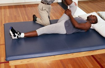 Physical therapists help patients with strength-building exercises.