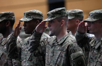 U.S. Army soldiers salute superiors at a military base in Wiesbaden, Germany.