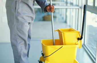 A sales representative shows the benefits of having a cleaning service to clients.