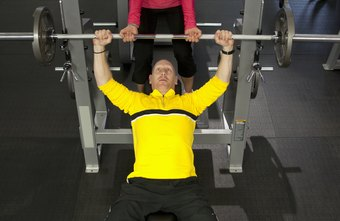 Personal trainers assist individuals with workout routines.