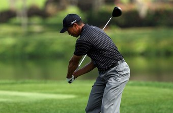 Tiger Woods creates power by lagging the club behind his hands.