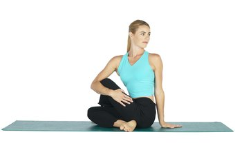 Ardha Matsyendrasana, a variation of Seated Pretzel Stretch, stretches your glutes.