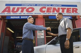 Service writers help build customer satisfaction in auto centers.