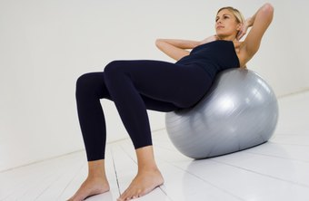 Firm up your belly by doing crunches on an exercise ball.