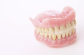 Dental lab technicians assist dentists by creating dentures.