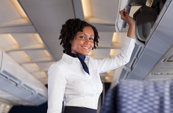 A flight attendant must be able to reach the overhead bins.
