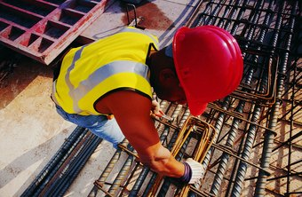 Iron workers install mesh, steel bars or cables to reinforce concrete.