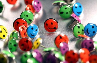 Novelty thumbtacks can express personality on an executive bulletin board.