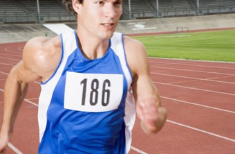 A sprinter pumps his arms to run faster.