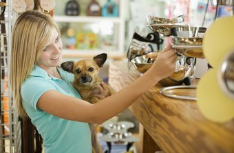 While some stores welcome dogs, laws prohibit most dogs from grocery stores.