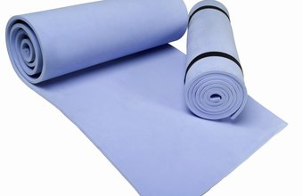 A rolled up yoga mat can help you wih Pilates pelvic floor breathing.