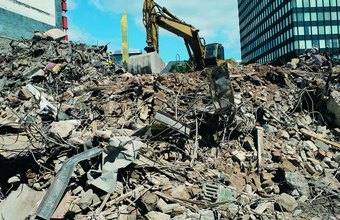 Demolition experts frequently have to remove buildings that are quite close to other structures.