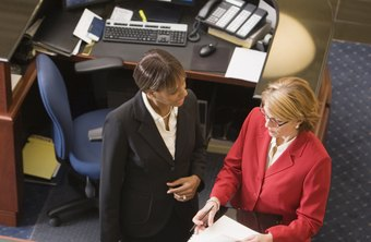 Legal secretaries in public defender's offices organize clients' files.