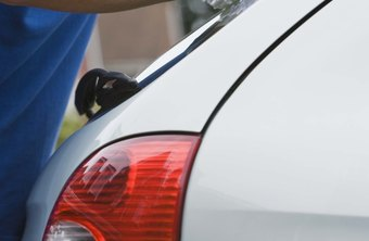 Mobile car detailers polish clients' cars with wax to enhance the paint job's appearance.