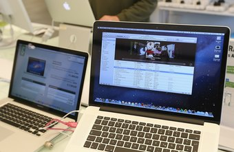 A MacBook Pro and a desktop PC can get along fine in a wireless network.