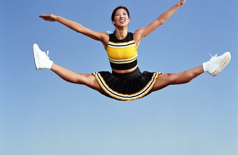 Cheerleaders perform side splits in the air.