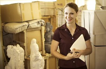 Museum collections managers oversee shipment of objects on loan.