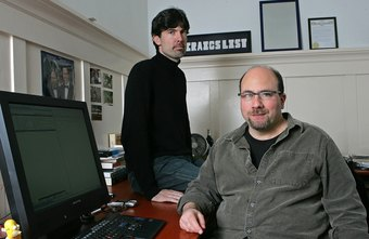 Craig Newmark, seated, and Jim Buckmaster are leaders of Craiglist.org.