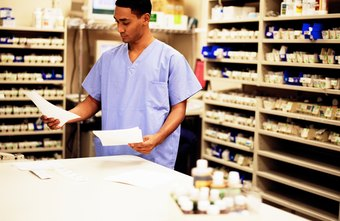 Pharmacy technicians fill out paperwork.
