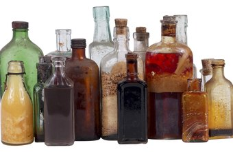 Attractive display of merchandise, like these antique bottles, attracts customers to your booth.