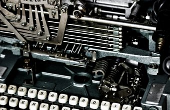 Cast-iron manual typewriters represent a bygone era in business communication.