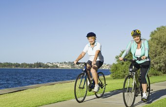 Aerobic exercises such as bike riding can contribute to overall fat loss.