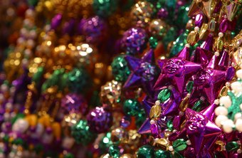 Pass out Mardi Gras beads to your customers.