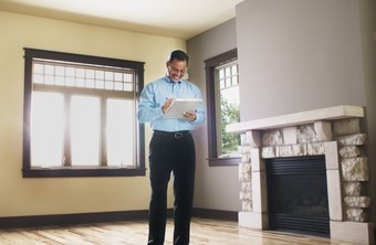 Home inspectors review a house before a purchase is finalized.