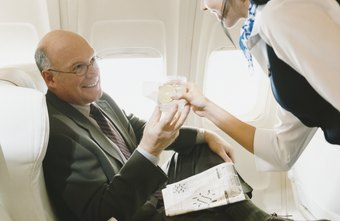 Flight attendants serve food and beverages to passengers.