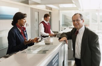 Airport ticket agents may be able to help you upgrade your flight.