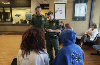 Border Patrol agents patrol train stations searching for illegal immigrants.