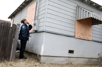 Code enforcement officers enforce builing and construction ordinances.