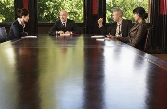 Legal meeting at table with arbitrator present