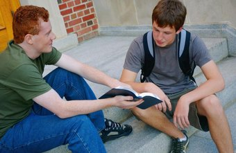 A Sunday school teacher tutoring a young man on the steps of a church.