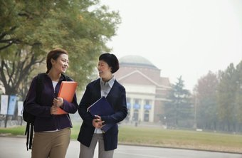 Academic advisor speaking with student on campus.