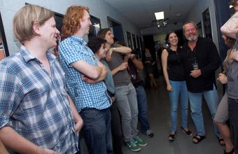 Band members standing in a hallway with their tour manager.